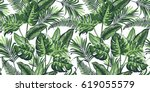 tropical palm leaves background.... | Shutterstock .eps vector #619055579