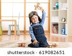 happy child toddler playing... | Shutterstock . vector #619082651