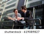 team is talking in front of... | Shutterstock . vector #619089827