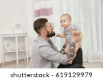 handsome tattooed young man... | Shutterstock . vector #619129979