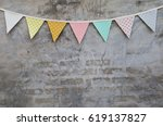 colorful party flag over cement ... | Shutterstock . vector #619137827