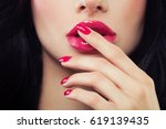 female lips and nails closeup.... | Shutterstock . vector #619139435