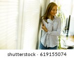 young woman standing by the... | Shutterstock . vector #619155074