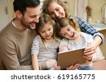 happy family spending time at... | Shutterstock . vector #619165775
