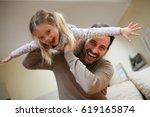 cute young daughter on a piggy... | Shutterstock . vector #619165874