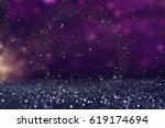 glitter vintage lights background. gold, purple and black. de-focused. - stock photo