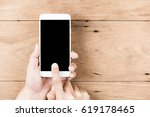 hands of man touching white... | Shutterstock . vector #619178465