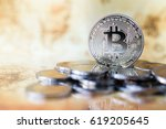 Small photo of Silver bitcoin with reflex and retro map background. Bit coin cryptocurrency banking money transfer business technology