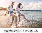 happy female friends holding...   Shutterstock . vector #619215365