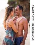 wet woman touching chest of... | Shutterstock . vector #619218959