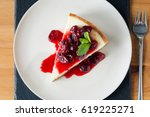 cheesecake on plate with cherry ... | Shutterstock . vector #619225271