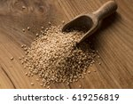 spoon with sesame seeds  on... | Shutterstock . vector #619256819