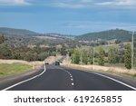 beautiful road in autumn in the ...   Shutterstock . vector #619265855
