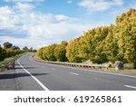beautiful road in autumn in the ... | Shutterstock . vector #619265861