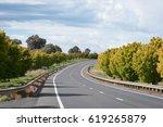 beautiful road in autumn in the ...   Shutterstock . vector #619265879