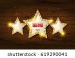retro light sign. three gold... | Shutterstock .eps vector #619290041