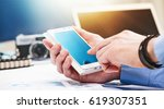 men's hands use smart phone for ... | Shutterstock . vector #619307351