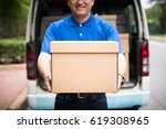 young delivery man in blue... | Shutterstock . vector #619308965
