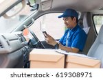 young delivery man in blue... | Shutterstock . vector #619308971