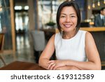 happy elegant asian middle aged ... | Shutterstock . vector #619312589