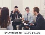 business meeting. young happy...   Shutterstock . vector #619314101