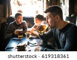 man drink beer in front of to... | Shutterstock . vector #619318361