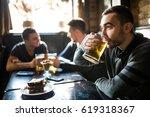man drink beer in front of to...   Shutterstock . vector #619318367