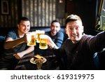 three young men in casual...   Shutterstock . vector #619319975