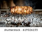 making home made cag kebab... | Shutterstock . vector #619326155