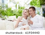 a happy young couple in a cafe | Shutterstock . vector #61934440