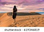 woman walking in the desert...   Shutterstock . vector #619346819