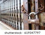 padlock on rusty chain | Shutterstock . vector #619347797