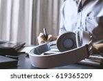 closeup headphones and... | Shutterstock . vector #619365209