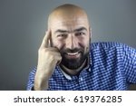 portrait of a young bearded... | Shutterstock . vector #619376285