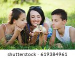 family with little yellow... | Shutterstock . vector #619384961
