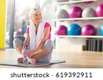 senior woman at the gym  | Shutterstock . vector #619392911