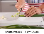 woman hands cutting the spring... | Shutterstock . vector #61940038