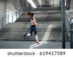 woman running in urban... | Shutterstock . vector #619417589