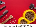 Stock photo pet accessories on red background top view 619426514