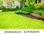 green lawn  the front lawn for... | Shutterstock . vector #619453691