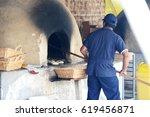 man baking bread ina a rustic... | Shutterstock . vector #619456871