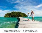 family walking on wooden...   Shutterstock . vector #619482761