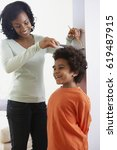 african mother measuring son's... | Shutterstock . vector #619487915