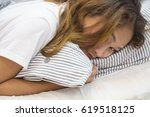 young asian woman sleep in bed... | Shutterstock . vector #619518125