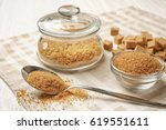 brown sugar in spoon and... | Shutterstock . vector #619551611