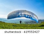 A Paraglider Launching From The ...