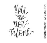 you are not alone lettering.... | Shutterstock .eps vector #619553714