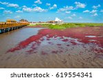 Small photo of PANJIN, LIAONING, CHINA - 29AUG2016: The Red Beach, located in the Liaohe Delta. The beach is a marshy area of suaeda grass and is of huge importance to bird life.