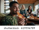 afro american man eating slice... | Shutterstock . vector #619556789