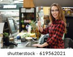 picture of cheerful cashier... | Shutterstock . vector #619562021